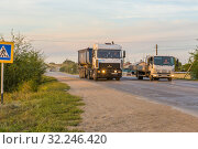 Купить «Russia, Samara, June 2016: Prohibited overtaking of a truck at a pedestrian crossing.», фото № 32246420, снято 24 августа 2016 г. (c) Акиньшин Владимир / Фотобанк Лори