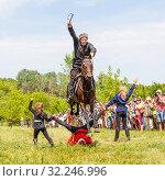 Купить «Russia, Samara, July 2016: Cossack performs tricks on a galloping horse», фото № 32246996, снято 18 июня 2016 г. (c) Акиньшин Владимир / Фотобанк Лори