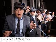 Купить «Excited man in virtual reality room», фото № 32248088, снято 29 января 2019 г. (c) Яков Филимонов / Фотобанк Лори