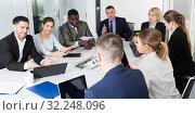 Купить «Multinational team of confident business partners discussing», фото № 32248096, снято 10 марта 2018 г. (c) Яков Филимонов / Фотобанк Лори
