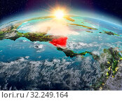 Купить «Satellite view of Nicaragua highlighted in red on planet Earth with clouds during sunrise. 3D illustration. Elements of this image furnished by NASA.», фото № 32249164, снято 29 марта 2020 г. (c) easy Fotostock / Фотобанк Лори