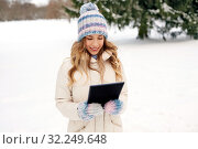 Купить «woman with tablet computer outdoors in winter», фото № 32249648, снято 20 января 2019 г. (c) Syda Productions / Фотобанк Лори