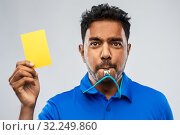 indian referee whistling and showing yellow card. Стоковое фото, фотограф Syda Productions / Фотобанк Лори
