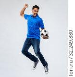 Купить «man or football fan with soccer ball jumping», фото № 32249880, снято 8 сентября 2019 г. (c) Syda Productions / Фотобанк Лори