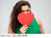 Купить «happy woman in green dress holding red heart», фото № 32249896, снято 15 сентября 2019 г. (c) Syda Productions / Фотобанк Лори