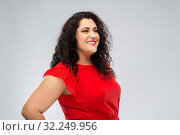 Купить «happy woman in red dress over grey background», фото № 32249956, снято 15 сентября 2019 г. (c) Syda Productions / Фотобанк Лори