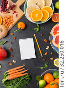 close up of notebook, fruits and vegetables. Стоковое фото, фотограф Syda Productions / Фотобанк Лори