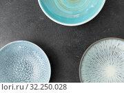 Купить «close up of blue ceramic plate on slate background», фото № 32250028, снято 5 апреля 2018 г. (c) Syda Productions / Фотобанк Лори