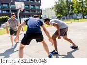 Купить «group of male friends playing street basketball», фото № 32250048, снято 21 июля 2019 г. (c) Syda Productions / Фотобанк Лори