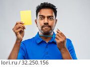 Купить «indian referee whistling and showing yellow card», фото № 32250156, снято 8 сентября 2019 г. (c) Syda Productions / Фотобанк Лори