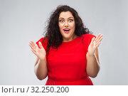 Купить «happy surprised woman in red dress», фото № 32250200, снято 15 сентября 2019 г. (c) Syda Productions / Фотобанк Лори