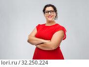 Купить «happy woman in glasses with crossed arms», фото № 32250224, снято 15 сентября 2019 г. (c) Syda Productions / Фотобанк Лори