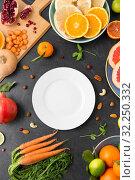Купить «plate, vegetables and fruits on on slate table», фото № 32250332, снято 5 апреля 2018 г. (c) Syda Productions / Фотобанк Лори