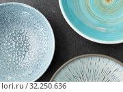 Купить «close up of blue ceramic plate on slate background», фото № 32250636, снято 5 апреля 2018 г. (c) Syda Productions / Фотобанк Лори