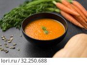 Купить «close up of pumpkin cream soup and vegetables», фото № 32250688, снято 5 апреля 2018 г. (c) Syda Productions / Фотобанк Лори
