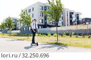 Купить «businessman with backpack riding electric scooter», фото № 32250696, снято 1 августа 2019 г. (c) Syda Productions / Фотобанк Лори