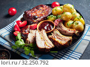 Купить «close-up of grilled pork ribs and veggies», фото № 32250792, снято 18 июня 2019 г. (c) Oksana Zh / Фотобанк Лори