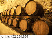 Купить «Wine barrels stacked in the old cellar of the winery», фото № 32250836, снято 16 мая 2014 г. (c) Наталья Волкова / Фотобанк Лори