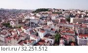 Купить «Aerial view of old center of Lisbon with Santa Maria Maior (or Se Cathedral), Portugal», видеоролик № 32251512, снято 20 апреля 2019 г. (c) Яков Филимонов / Фотобанк Лори