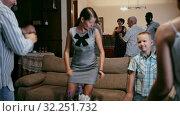 Купить «Adults and children dancing at a party at home», видеоролик № 32251732, снято 15 декабря 2019 г. (c) Яков Филимонов / Фотобанк Лори