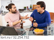 Купить «Best friends talk and drink beer in the kitchen», фото № 32254732, снято 13 марта 2019 г. (c) Яков Филимонов / Фотобанк Лори
