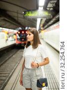 Купить «Woman waiting subway car on platform», фото № 32254764, снято 18 октября 2019 г. (c) Яков Филимонов / Фотобанк Лори