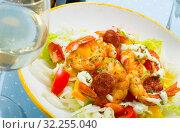Купить «Salad of fried shrimp, sausage and vegetables», фото № 32255040, снято 20 ноября 2019 г. (c) Яков Филимонов / Фотобанк Лори