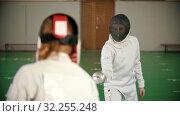 Купить «Two young women fencers having a training in the school gym», видеоролик № 32255248, снято 10 апреля 2020 г. (c) Константин Шишкин / Фотобанк Лори