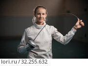 Купить «A portrait of a young smiling woman fencer bending a singlestick», фото № 32255632, снято 5 октября 2019 г. (c) Константин Шишкин / Фотобанк Лори