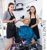 Купить «Hairstylists and satisfied female customer after haircut», фото № 32256172, снято 26 июня 2018 г. (c) Яков Филимонов / Фотобанк Лори
