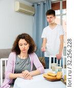 Sad woman after discord with teen son. Стоковое фото, фотограф Яков Филимонов / Фотобанк Лори