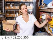 Купить «Female customer in building store», фото № 32256356, снято 20 сентября 2018 г. (c) Яков Филимонов / Фотобанк Лори