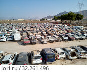 Купить «Aerial view new damaged cars due to flooding in dirt, spoiled can not be restored and used, gota fria September 2019, Orihuela, Torrevieja, Spain», фото № 32261496, снято 21 сентября 2019 г. (c) Alexander Tihonovs / Фотобанк Лори