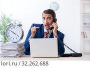 Купить «Young male businessman sitting in the office», фото № 32262688, снято 20 июня 2019 г. (c) Elnur / Фотобанк Лори