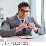 Купить «Man looking for errors and mistakes in report», фото № 32264232, снято 2 марта 2017 г. (c) Elnur / Фотобанк Лори