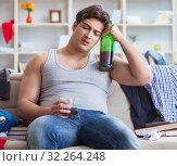 Купить «Young man student drunk drinking alcohol in a messy room», фото № 32264248, снято 4 апреля 2017 г. (c) Elnur / Фотобанк Лори