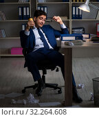 Купить «The businessman tired and sleeping in the office after overtime», фото № 32264608, снято 21 декабря 2017 г. (c) Elnur / Фотобанк Лори