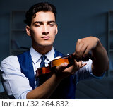 Купить «Young musician man practicing playing violin at home», фото № 32264832, снято 15 августа 2017 г. (c) Elnur / Фотобанк Лори