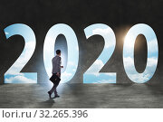 Купить «Businessman and concept of new year 2020», фото № 32265396, снято 17 февраля 2020 г. (c) Elnur / Фотобанк Лори