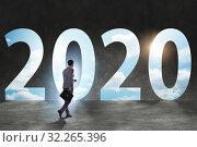 Купить «Businessman and concept of new year 2020», фото № 32265396, снято 11 марта 2020 г. (c) Elnur / Фотобанк Лори