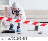 Купить «Forensic expert at crime scene doing investigation», фото № 32265468, снято 7 сентября 2017 г. (c) Elnur / Фотобанк Лори