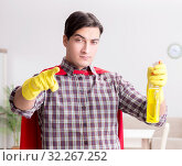 Купить «The super hero cleaner doing housework», фото № 32267252, снято 22 декабря 2016 г. (c) Elnur / Фотобанк Лори