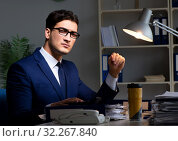 Купить «Employee working late to finish important deliverable task», фото № 32267840, снято 21 декабря 2017 г. (c) Elnur / Фотобанк Лори