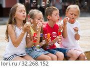 Купить «children blowing bubbles outdoors», фото № 32268152, снято 1 июля 2020 г. (c) Яков Филимонов / Фотобанк Лори