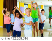 Купить «boys and girls dancing rock-and-roll in pairs with female trainer», фото № 32268316, снято 17 октября 2019 г. (c) Яков Филимонов / Фотобанк Лори