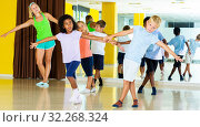 Купить «boys and girls dancing rock-and-roll in pairs with female trainer», фото № 32268324, снято 31 июля 2019 г. (c) Яков Филимонов / Фотобанк Лори