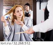 Купить «Young woman is not happy with her hair», фото № 32268512, снято 7 марта 2017 г. (c) Яков Филимонов / Фотобанк Лори
