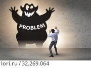 Купить «Businessman afraid of big problem», фото № 32269064, снято 14 октября 2019 г. (c) Elnur / Фотобанк Лори
