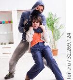 Купить «Armed man assaulting young woman at home», фото № 32269124, снято 15 декабря 2017 г. (c) Elnur / Фотобанк Лори