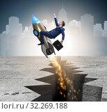 Купить «Businessman flying on rocket from rock gap», фото № 32269188, снято 5 июня 2020 г. (c) Elnur / Фотобанк Лори